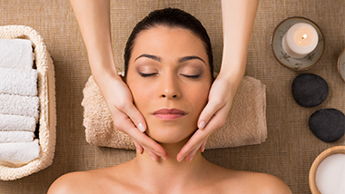 woman getting a facial massage in the spa