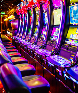 A row of electronic slot machines.