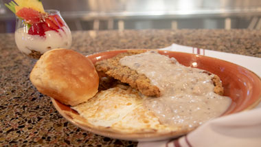 Chicken Friend Steak with gravy, biscuit and eggs