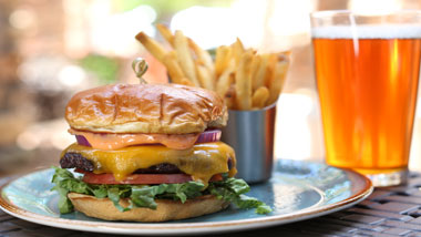 99 Hops House Burger with fries and beer